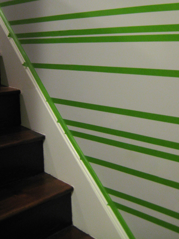 Photo showing the pattern taped out on the wall.