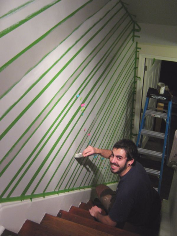 Logan painting the stripes.