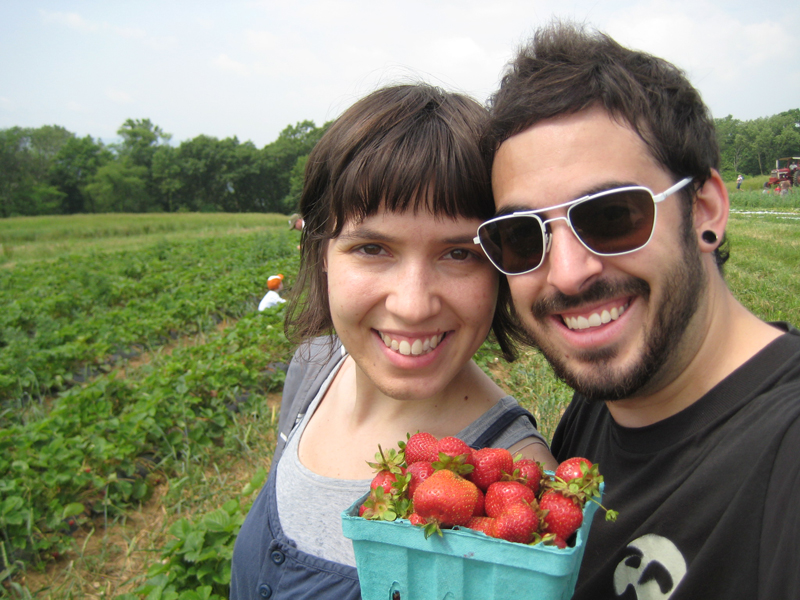 Logan and Valerie with our basket of strawberries.
