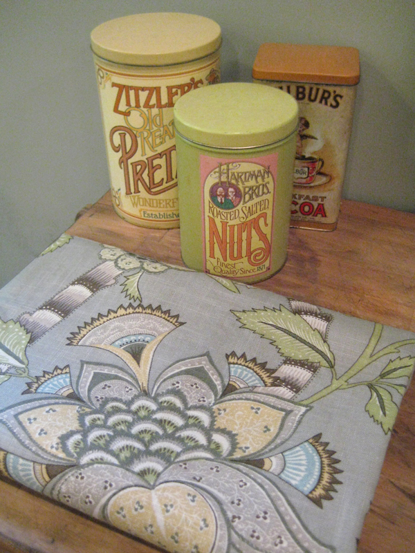 Fabric shown next to vintage tins.