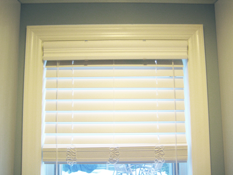 Close-up of white wooden blinds.