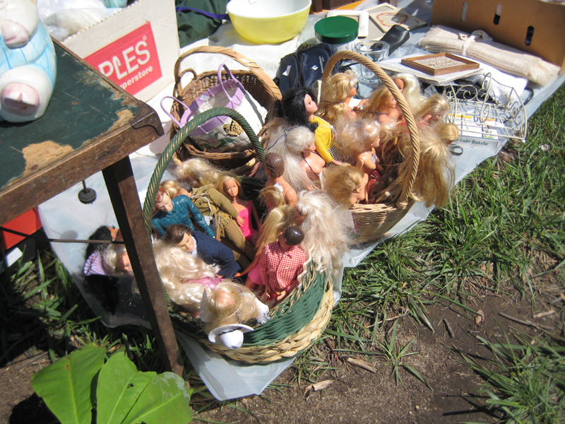 A photo of baskets full of barbies.
