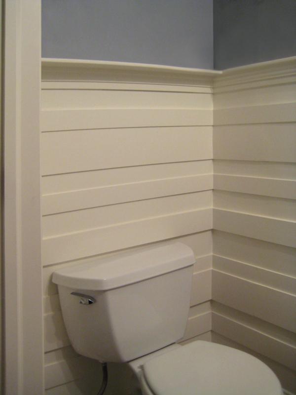 Paneling behind toilet