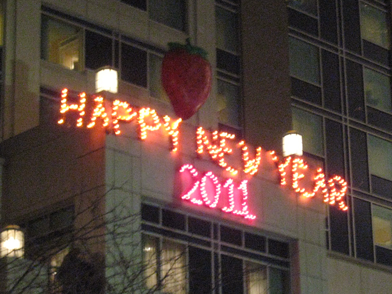 Happy New Year sign all lit up at 12:01 am