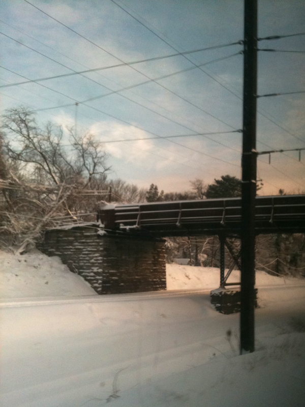 Railroad bridge in the snow.