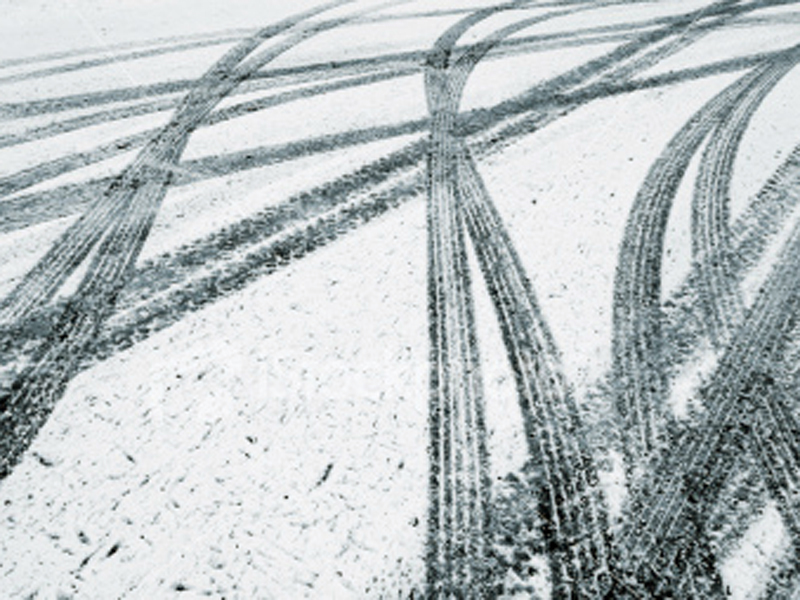 Car tracks in the snow.