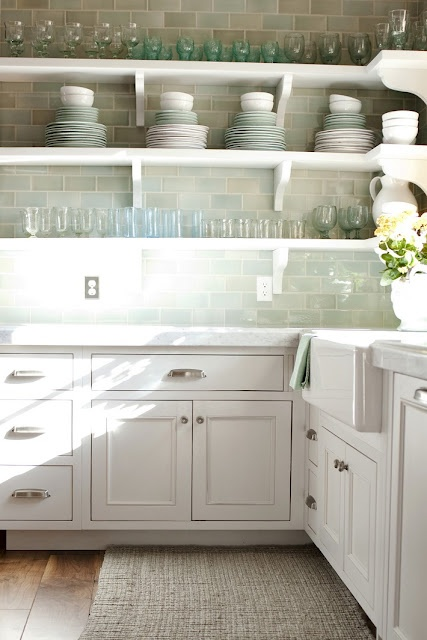 Kitchen with open shelving and subtle color palette.