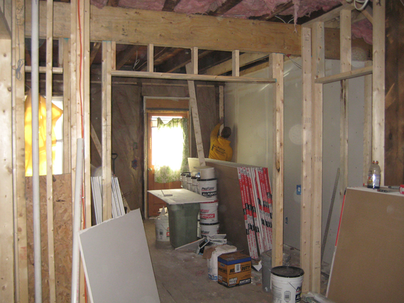 View of living room and front door during renovation