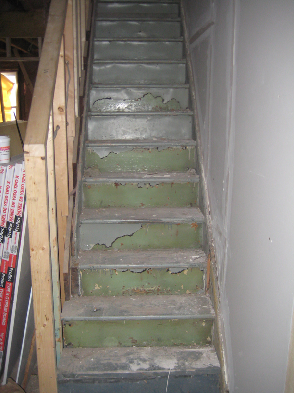 View of 100 year old painted stairway during renovation