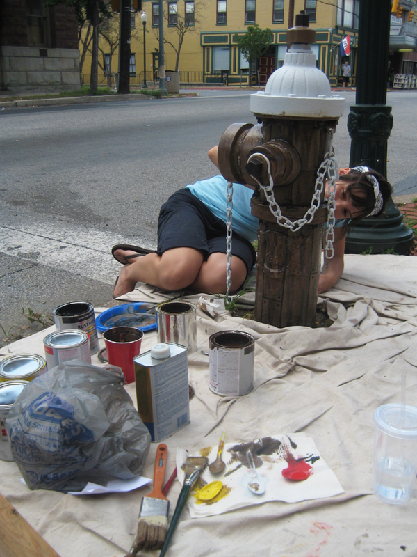 Valerie painting fire hydrant.