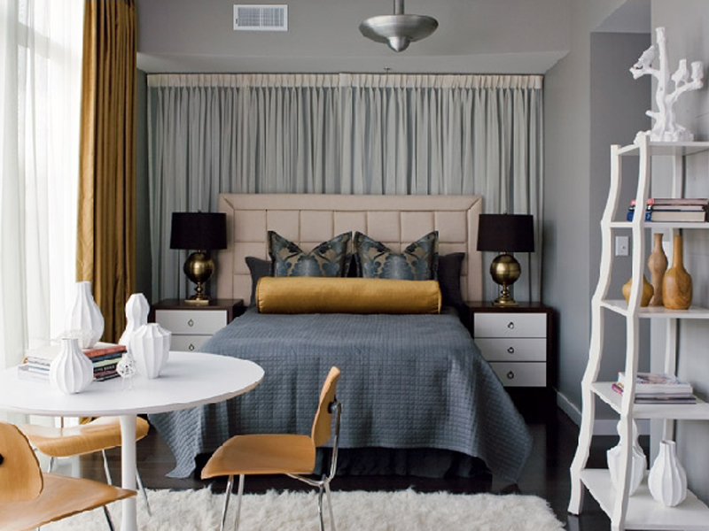 Blue-grey and gold bedroom.