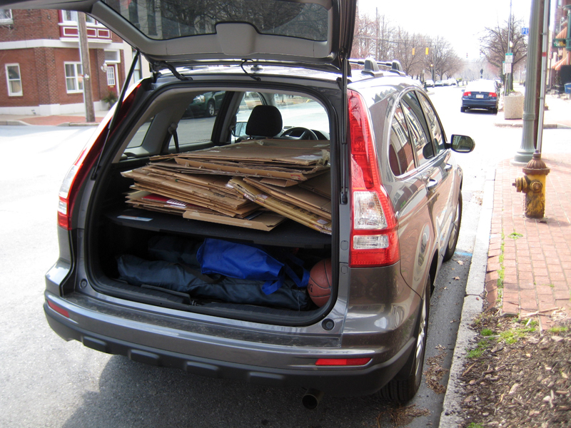 Image showing car with cardboard in trunk