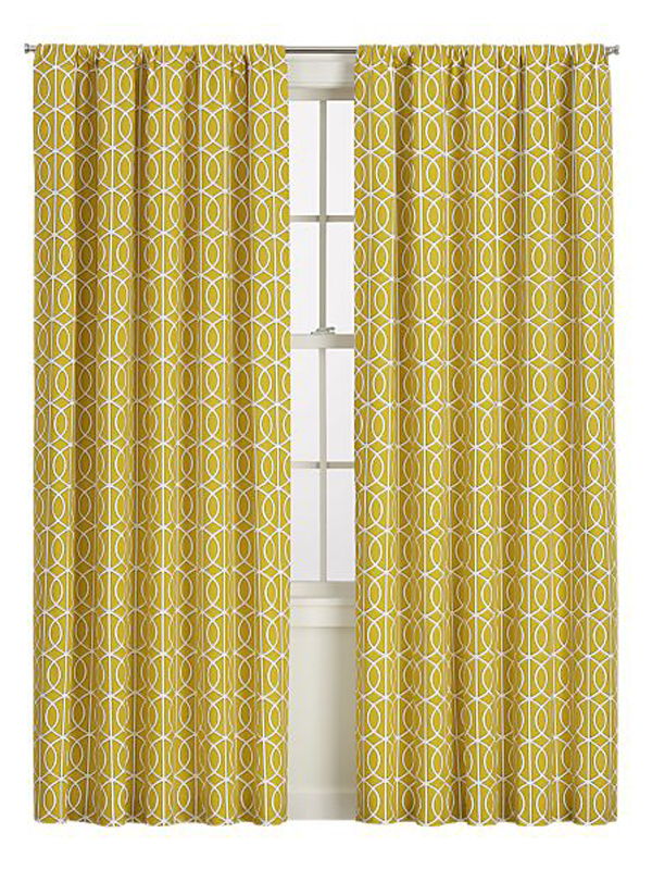 Yellow geometric patterned drapery panels.