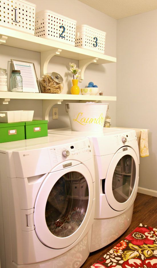 Laundry room with creative storage.