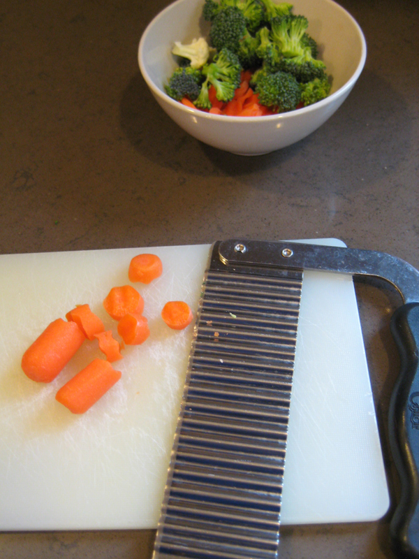 Chopped vegetables on cutting board.