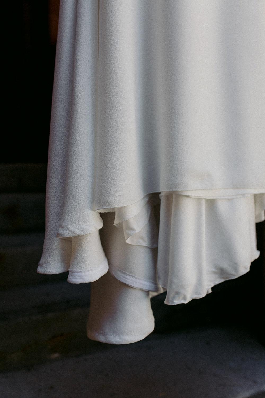 Wedding Dress Hanging in Hallway.
