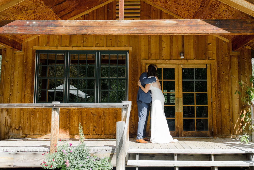 Bride and Groom Hugging after First Look.