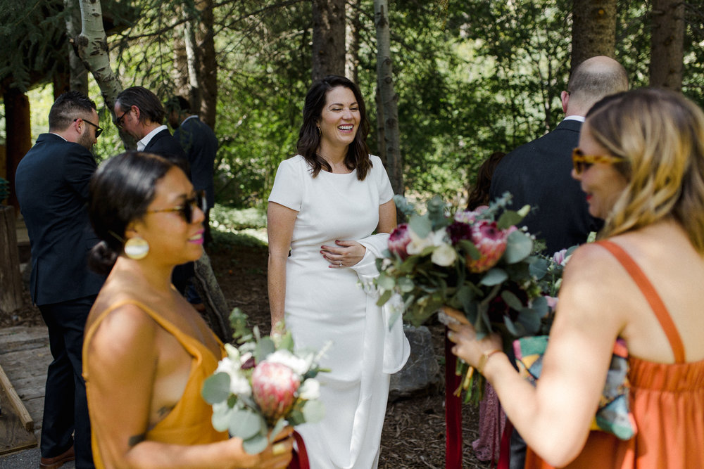 Bride with friends laughing.