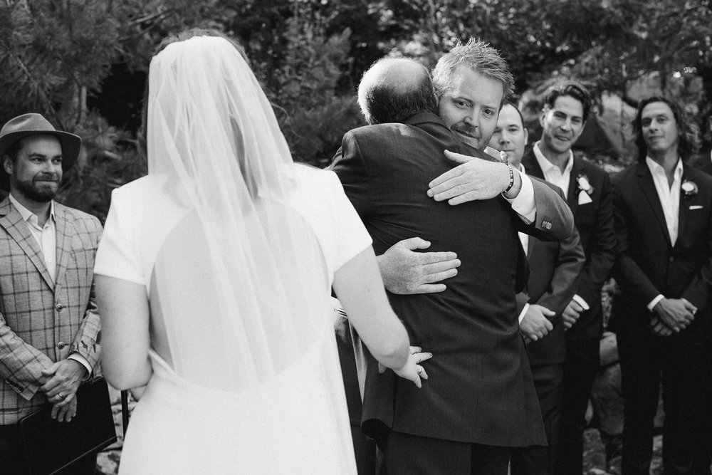 Groom Hugging Father In Law.