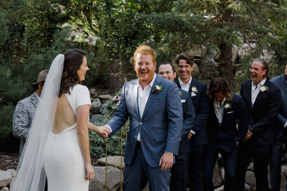 Groom Laughing at Ceremony.