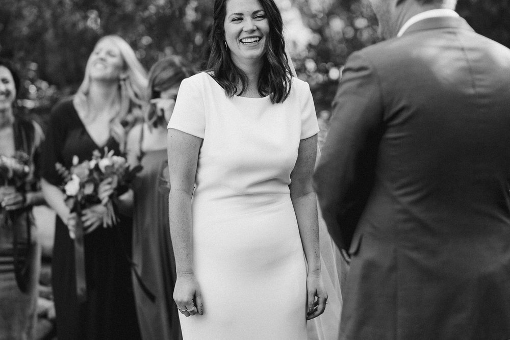 Bride Laughing at Ceremony.