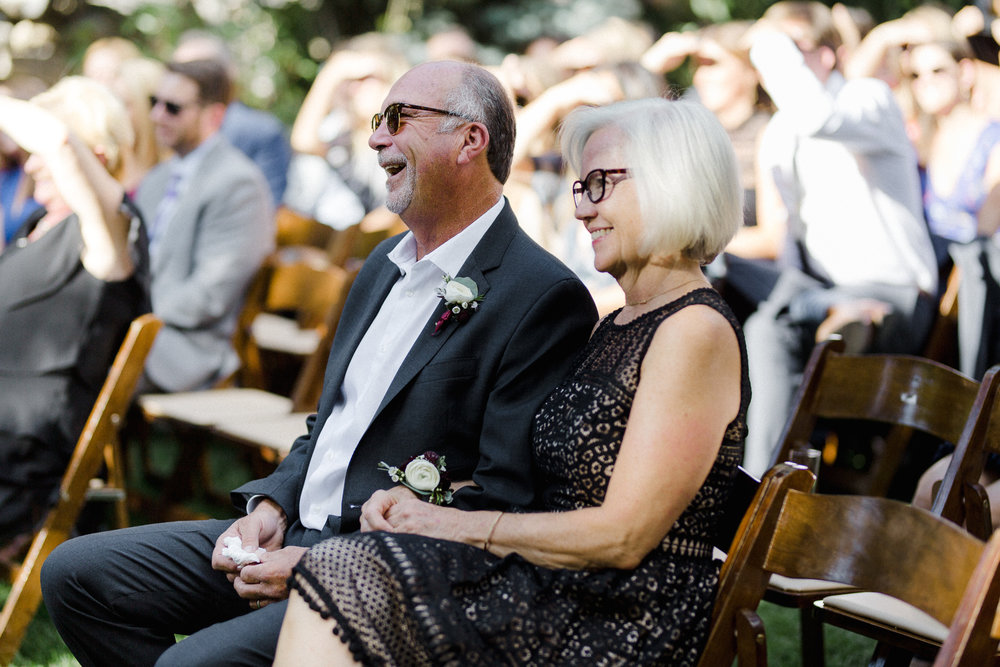 Parents Laughing at Ceremony.