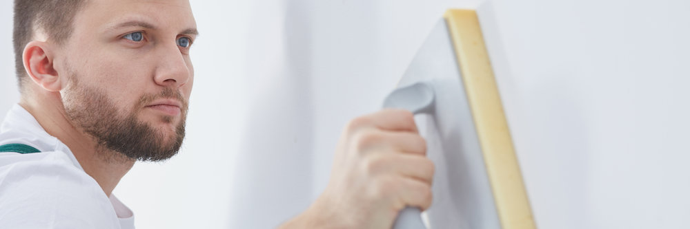 Professional contractor plastering wall