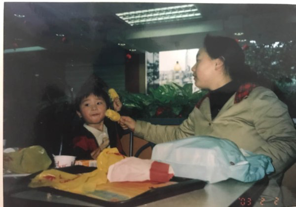 Aunt Liao (right) took care of Zhu for much of his childhood.