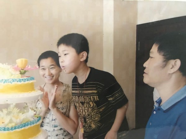 Zhu blows out the candles on his cake at his 10th birthday party.