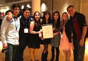 Editor-in-chief Tynin Fries, '14, (center right) and The Feather editors and adviser Greg Stobbe, right, earned a Gold Crown at the 2013 CSPA convention.