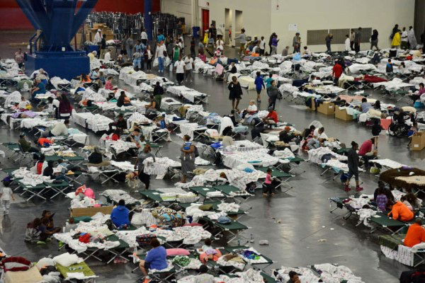 August 28, 2017. George R. Brown Convention Center, Red Cross Mega Shelter Houston, Texas. Shelter residents in communal sleeping quarters.