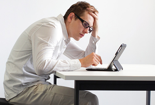 493ss_thinkstock_rf_man_hunched_over_tablet.jpg