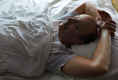 493ss_thinkstock_rf_man_sleeping_on_back.jpg