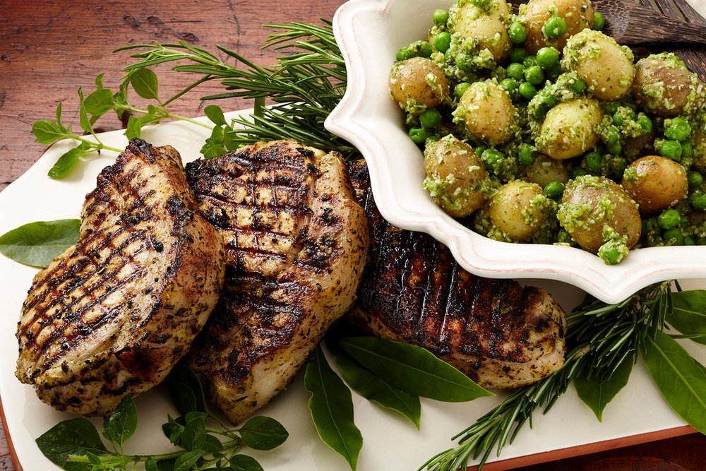 Pork with pesto peas and potatoes