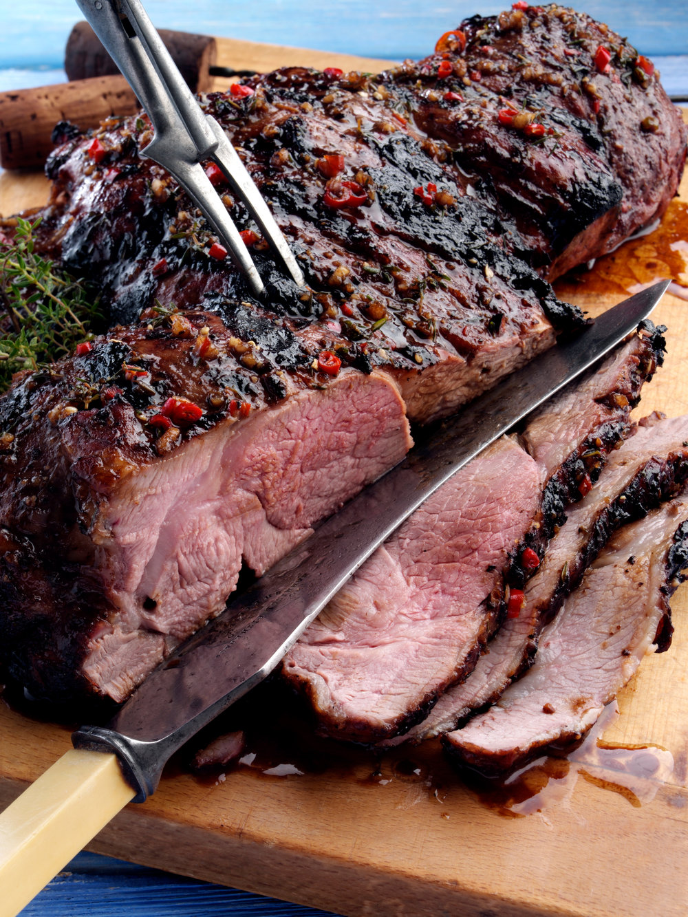 Marinaded barbecued butterflied leg of lamb
