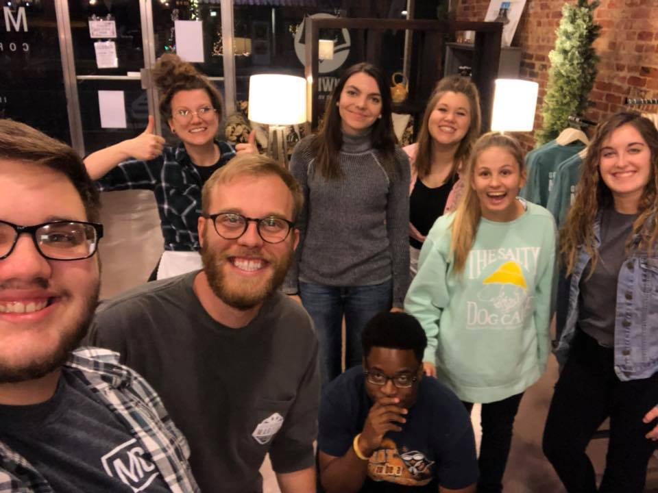 Letters in Motion student chapter helping out with Friends Trivia Night at Martin Coffeehouse.