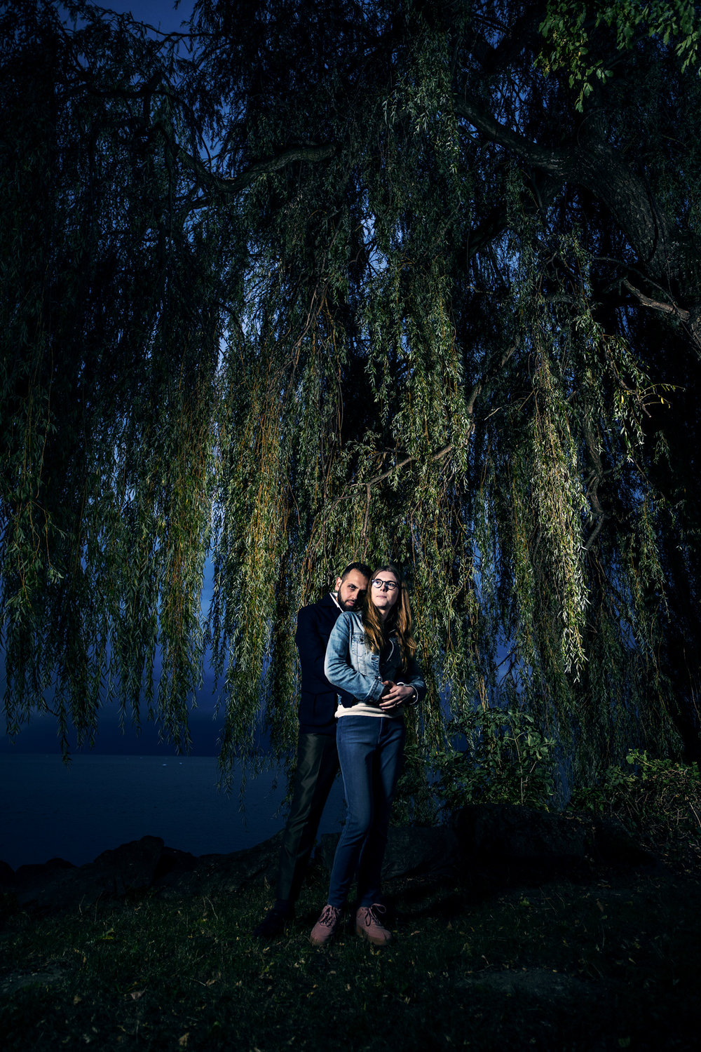 - We headed back to the Willow tree so Raj could capture some more dramatic night time photos under the tree branches.This evening couple photoshoot worked really well to give them a variety of pretty natural light photos as well as these moody dramatic photos as the sun set.
