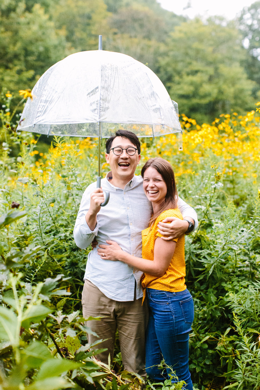 Rainy Engagement Pictures // Sunflower Field Engagement Photos Max Patch // Suzy Collins Photography