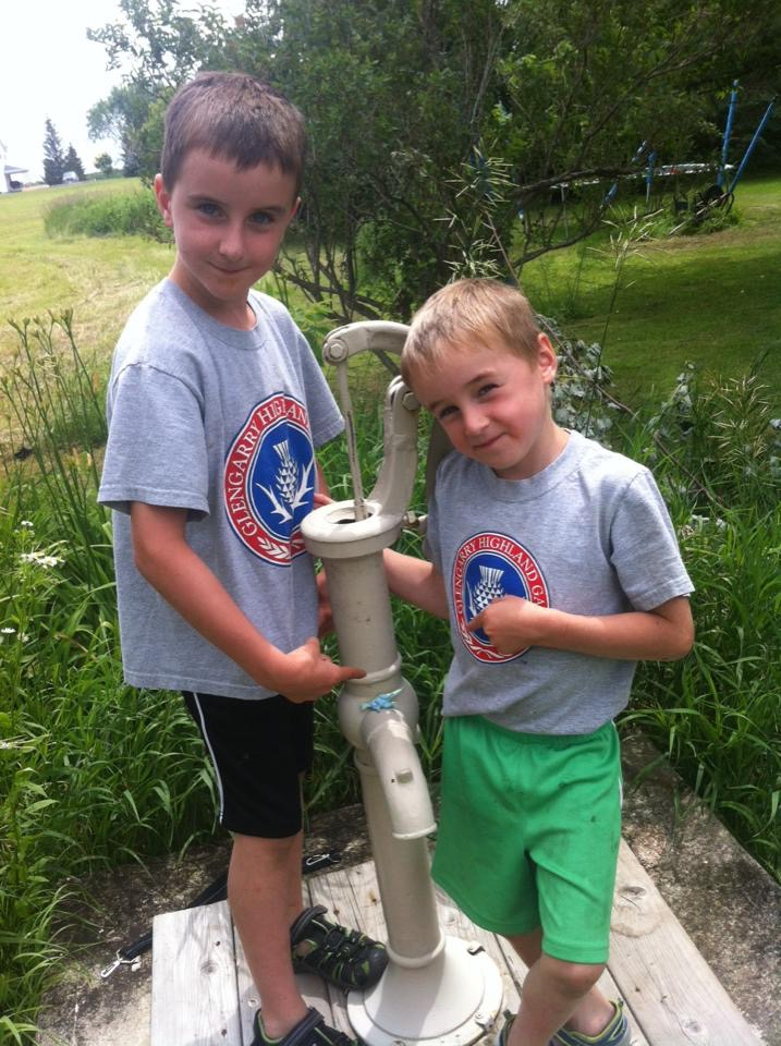 Travis A for this photo of his two sons proudly wearing their Games shirts as they discover a mini blue dinosaur.