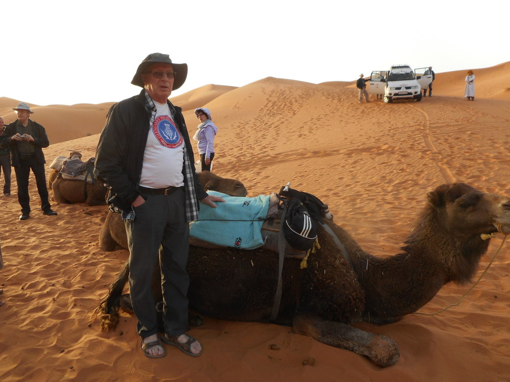 Dougal MacLeod camel riding in the Sahara in Morocco