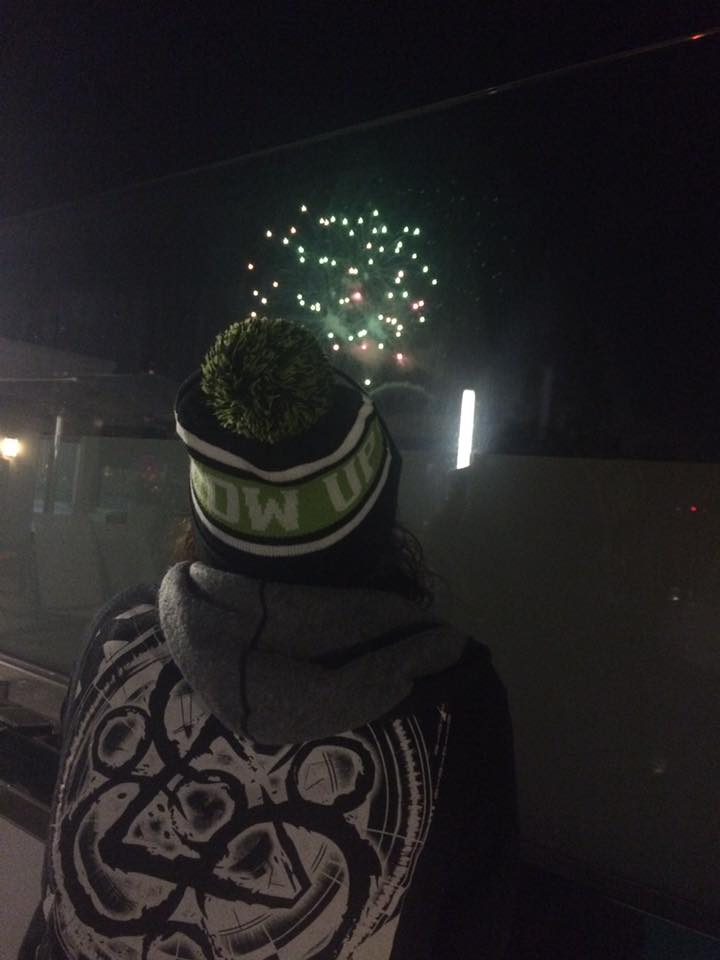 Ryan snuck a photo of me watching the fireworks from the roof at Carousel on one of our trips last winter.