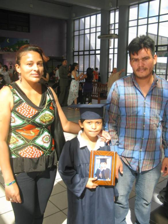 Richard with his wife Suyapa and son Axel at Axel's graduation. He was so happy and proud – despite his lack of desire to smile for the camera.