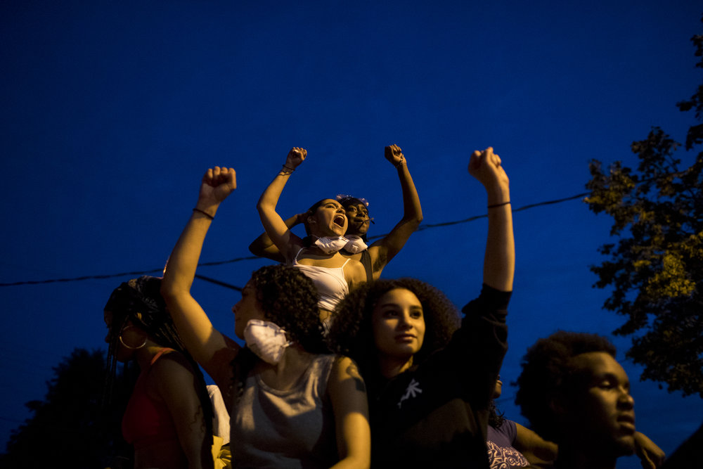 Mia Holmes (upper left) chants from the roof of a car during a march from the Minnesota State Capitol to I94 following Jeronimo Yanez' not guilty verdict, on Friday, June 16, 2017.