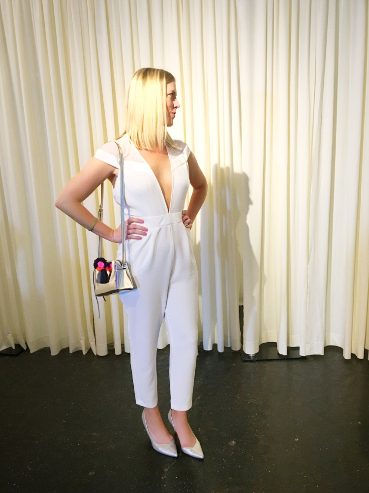 Stephanie Mack of The Borrowed Babes Fashion Blog wearing White ASOS Tall Plunge Neck Backless White Jumpsuit at St. Augustine Fashion Week in St. Augustine Florida 2017