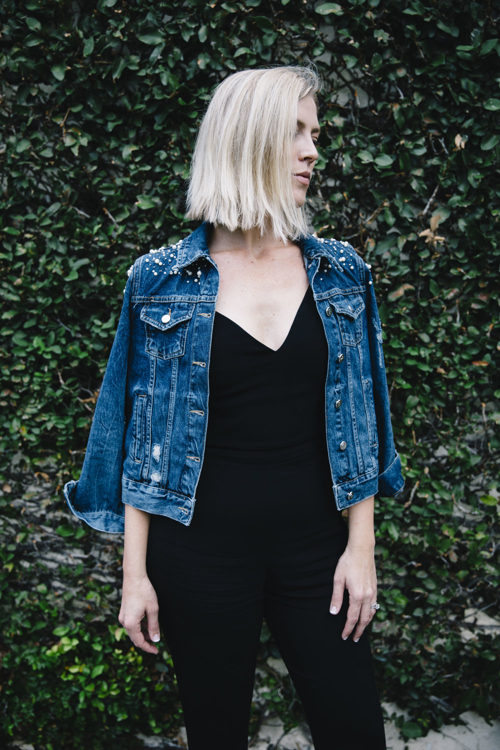 The Borrowed Babes Fashion Blogger Stephanie Mack Kearney wearing Anthropologie Embellished Denim Jacket with Cushnie Et Ochs Jumpsuit from Rent the Runway