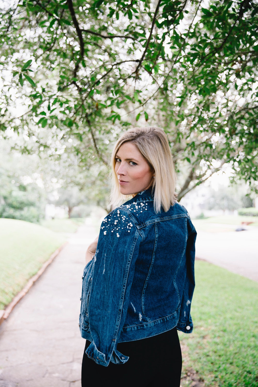 The Borrowed Babes Fashion Blogger Stephanie Mack Kearney wearing Anthropologie Embellished Denim Jacket with Cushnie Et Ochs Jumpsuit from Rent the Runway