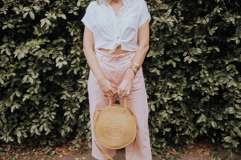 The Borrowed Babes Fashion Blogger, Stephanie Mack Kearney, wearing Rosé All Day Top by Rails with Tara Jarmon Pink Culottes and Clare V Yellow Woven Maison Bag all rented from Rent the Runway  Photo by Kelly Martucci – Jacksonville, Florida