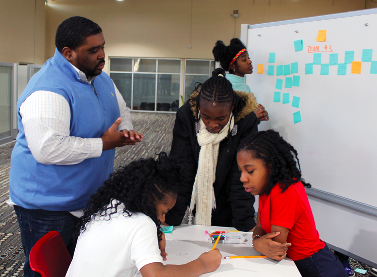 Marvin English, Founding Head of Venture School, works with students.