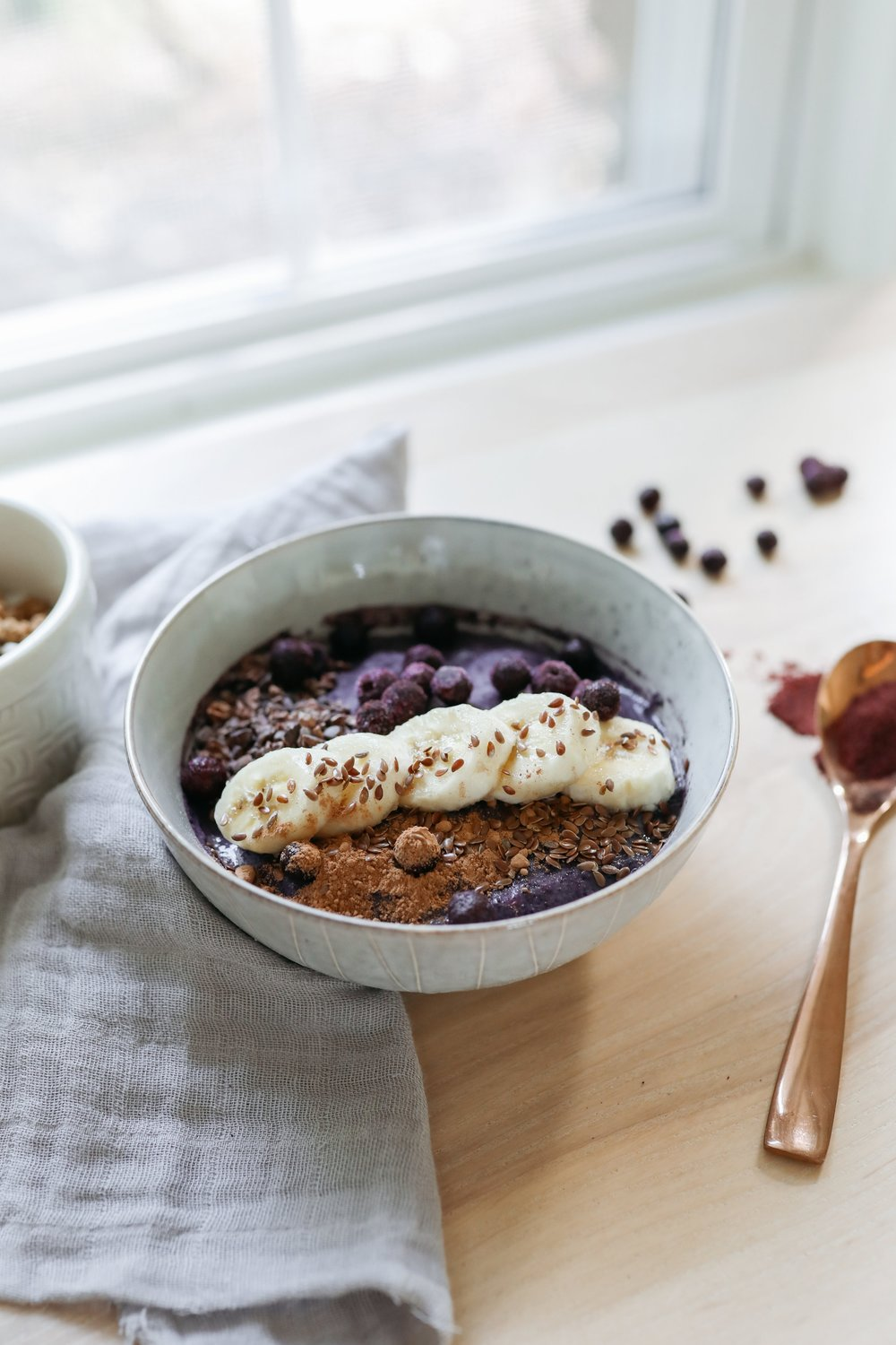 The purple acai smoothie bowl full of fruity goodness, a great smoothie recipe to start the day or have for lunch!