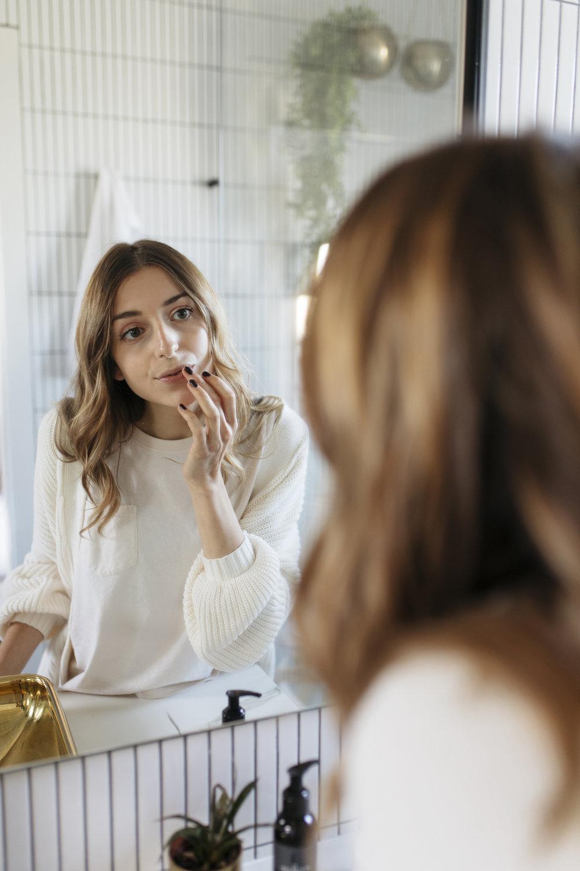 Applying lip scrub to enhance bare faced beauty